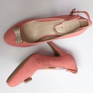 Pink faux suede bamboo heels with bow